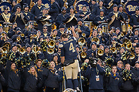 Pitt quarterback Nathan Peterman leads the Pitt band after the victory. The Pitt Panthers defeated the Syracuse Orange 76-61 at Heinz Field in Pittsburgh, Pennsylvania on November 26, 2016.