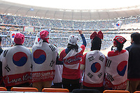 South Korea fans cheer their team on at Soccer City in Johannesburg, South Africa on Thursday, June 17, 2010 during Argentina's and South Korea FIFA World Cup first round match.
