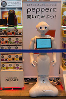 "SloftBank's first robot, Pepper greeting customers at LABI Electric shop in Shibuya, Tokyo<br /> ""Ask Pepper your most suitable Nescafe coffee machine"""