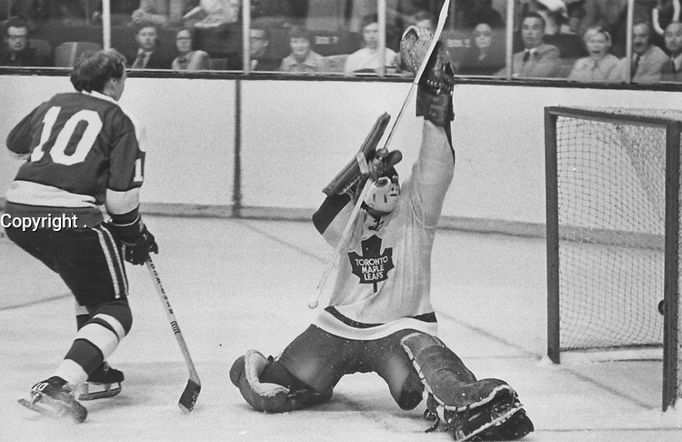 1973 FILE PHOTO -<br /> <br /> It's too late: Maple Leafs' goalie Doug Favell can only wave at puck, shot by Pittsburgh Penguins' Ted Snell, as it finds rigging behind him in first-period action at Gardens last night. Toronto's 4-game un was shattered, 4-2, as Greg Polis and Jea scored third-period goals to give the Penguins