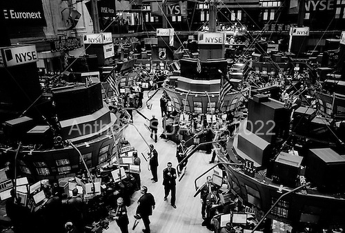 New York, New York.March 17, 2008 ..On the floor of the New York Stock Exchange as markets continue to swing at 100+ points a day up or down. The mortgage crisis is being played out on Wall Street investors and world's financial markets...On this day the Federal Reserve lowered the interest rates by 3/4s of a point to help support the failing economy. The previous day the Federal Reserve bailed out a major US bank - Bear Stearns with a $30 billion investment along side JP Morgan..