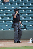 Home plate umpire John Budka makes a strike call during the Carolina League game between the Lynchburg Hillcats and the Winston-Salem Dash at BB&T Ballpark on May 9, 2019 in Winston-Salem, North Carolina. The Dash defeated the Hillcats 4-1. (Brian Westerholt/Four Seam Images)