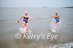 Laura Fitzgerald and Caroline Corkery kicking up a storm in the water in Fenit on Saturday morning.