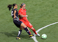 Washington Freedom's Becky Sauerbrunn and LA Sol's Marta. The LA Sol defeated the Washington Freedom 2-0 in the opening game of Womens Professional Soccer at Home Depot Center stadium on Sunday March 29, 2009.  .Photo by Michael Janosz