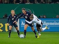 Lori Chalupny (17) alongside Simone Laudehr (6) against Yael Averbuch (12). US Women's National Team defeated Germany 1-0 at Impuls Arena in Augsburg, Germany on October 29, 2009.