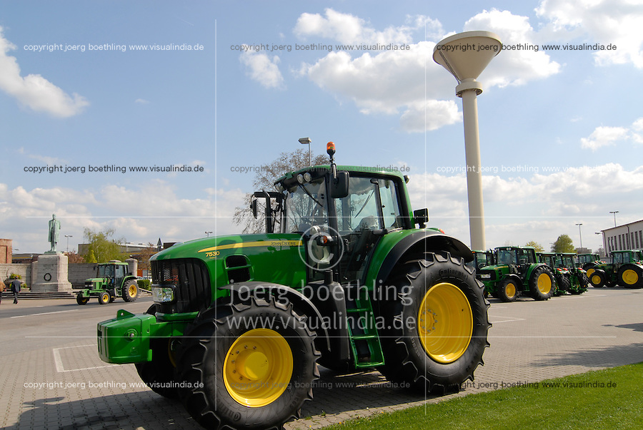 GERMANY, Mannheim, John Deere Tractor factory, new produced  tractor 7530 with continental rubber tyres, behind sculpture of Heinrich Lanz, the founder of former Lanz Bulldog factory which was acquired by John Deere in 1956 / DEUTSCHLAND, Mannheim, John Deere Traktorenfabrik ehemals Lanz Maschinenfabrik AG