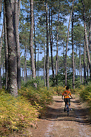 Boy mountain biking in Landes Forest, Aquitaine, France.
