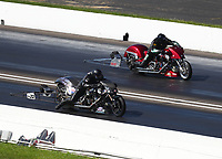 Aug 8, 2020; Clermont, Indiana, USA; NHRA top fuel nitro Harley Davidson motorcycle rider Tyler Wilson (near) alongside Tracy Kile during qualifying for the Indy Nationals at Lucas Oil Raceway. Mandatory Credit: Mark J. Rebilas-USA TODAY Sports