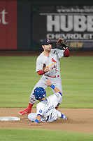 Greg Garcia (5) of the Memphis Redbirds on defense against the Omaha Storm Chasers in Pacific Coast League action at Werner Park on April 24, 2015 in Papillion, Nebraska.  (Stephen Smith/Four Seam Images)