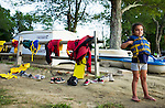 Watertown, CT- 19 August 2015-081915CM05- Ariana Estrada 5 of Waterbury, waits on the beach during canoe rides during family night at Camp Mataucha in Watertown on Wednesday, August 20th. 2015.  Christopher Massa Republican-American