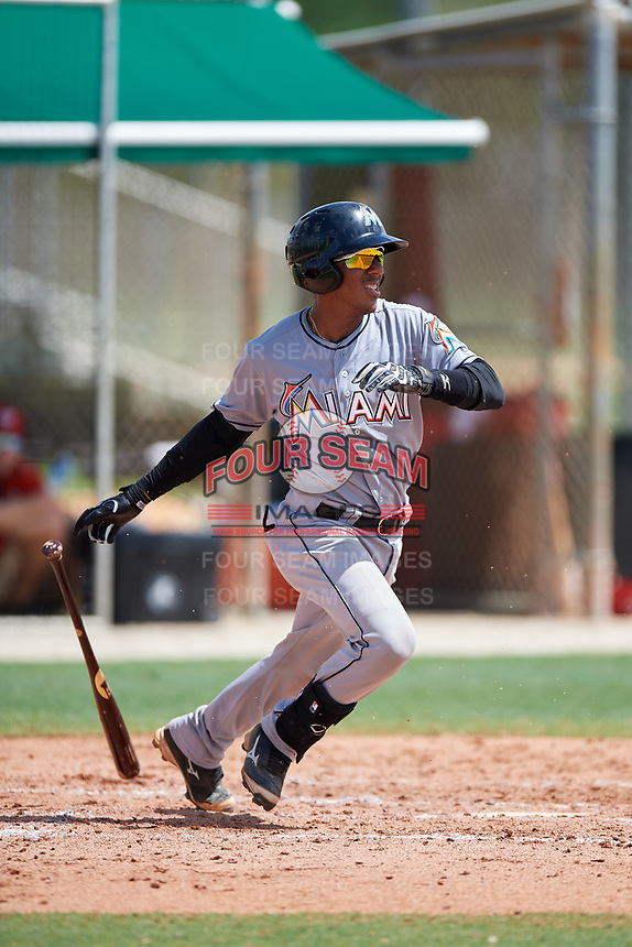 GCL Marlins catcher Pablo Garcia (4) follows through on a swing during the first game of a doubleheader against the GCL Nationals on July 23, 2017 at Roger Dean Stadium Complex in Jupiter, Florida.  GCL Nationals defeated the GCL Marlins 4-0.  (Mike Janes/Four Seam Images)