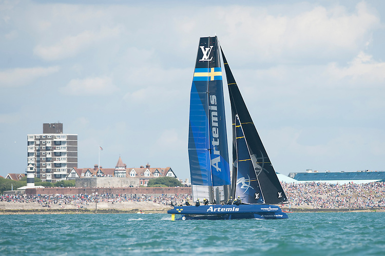 25 July 2015: Artemis Racing races in front of the crowds during the America's Cup first round racing off Portsmouth, England (Photo by Rob Munro)