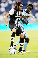 Newcastle United defender Jonas Gutierrez holds off the challenge from Kei Kamara Sporting KC... Sporting Kansas City and Newcastle United played to a 0-0 tie in an international friendly at LIVESTRONG Sporting Park, Kansas City, Kansas.