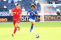 KANSAS CITY, KS - JULY 15: Alistair Johnson #2 of Canada runs  with the ball during a game between Canada and Haiti at Children's Mercy Park on July 15, 2021 in Kansas City, Kansas.