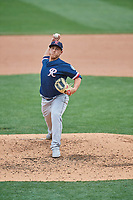 Jaime Schultz (9) of the Tacoma Rainiers delivers a pitch to the plate against the Salt Lake Bees at Smith's Ballpark on May 16, 2021 in Salt Lake City, Utah. The Bees defeated the Rainiers 8-7. (Stephen Smith/Four Seam Images)