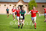 Churchill's Liam O'Donnell races ahead of Liam Sullivan and William Hurley of St Pats Blennerville in the County Senior football league on Sunday.