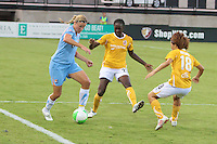 Jenni Branam (23) of Sky Blue FC fights to control the ball over Tina Ellertson (23) and Aya Miyama (18) of the Atlanta Beat. Sky Blue FC defeated the Atlanta Beat 2-1 during a Women's Professional Soccer (WPS) match at KSU Atlanta Beat Stadium Kennesaw, GA, on August 7, 2010...