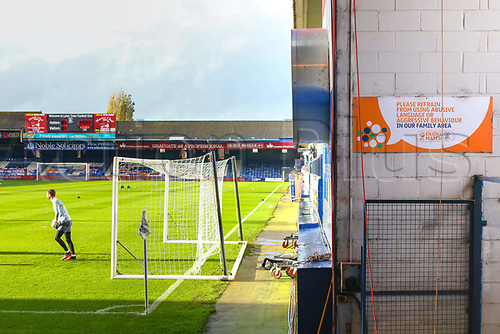 31st October 2020; Kenilworth Road, Luton, Bedfordshire, England; English Football League Championship Football, Luton Town versus Brentford; A family orientated sign is seen as the players warm up