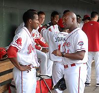 Manager Billy McMillon (51), left, of the Greenville Drive, talks with outfielder Felix Sanchez (34) in a game against the Augusta GreenJackets on August 27, 2011, at Fluor Field at the West End in Greenville, South Carolina. Greenville defeated Augusta, 10-4. (Tom Priddy/Four Seam Images)