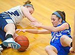 North East's Baily Kerr (blue) fights for a loose ball during the North East High School v Tome School girl's basketball game at the Tome School in North East, Maryland