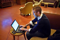 John Favreau, Barack Obama's Chief Speech Writer, at work on his victory speech for tonight's primary election, in a hotel lobby.