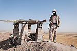 20/07/14  Iraq -- Daquq, Iraq -- A peshmerga on duty at a check point outside the base at the front line in Daquq.