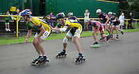 11 AUG 2013 - BIRMINGHAM, GBR - Ben Coole-Probert  (left) of Birmingham Wheels Roller Speed Club is propelled forward at the changeover by team mate Michal Roman (second from left) during the Junior and Senior Men's 3000m Relay at the Federation of Inline Speed Skating 2013 British Outdoor Championships at Birmingham Wheels Park in Birmingham, West Midlands, Great Britain (PHOTO COPYRIGHT © 2013 NIGEL FARROW, ALL RIGHTS RESERVED)