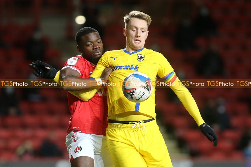 Joe Pigott of AFC Wimbledon controls the ball under pressure from Charlton's Adedeji Oshilaja during Charlton Athletic vs AFC Wimbledon, Sky Bet EFL League 1 Football at The Valley on 12th December 2020