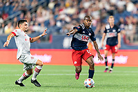 FOXBOROUGH, MA - JULY 7: Maciel #13 of New England Revolution brings the ball forward as Mark Delgado #8 of Toronto FC closes during a game between Toronto FC and New England Revolution at Gillette Stadium on July 7, 2021 in Foxborough, Massachusetts.