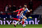 Angel Correa (L) of Atletico de Madrid fights for the ball with Unai Bustinza, Bustinza M, of CD Leganes during the La Liga 2017-18 match between Atletico de Madrid and CD Leganes at Wanda Metropolitano on February 28 2018 in Madrid, Spain. Photo by Diego Souto / Power Sport Images