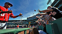 9 June 2012: Washington Nationals shortstop Ian Desmond signs autographs prior to a game against the Boston Red Sox at Fenway Park in Boston, MA. The Nationals defeated the Red Sox 4-2 in the second game of their 3-game series. Mandatory Credit: Ed Wolfstein Photo