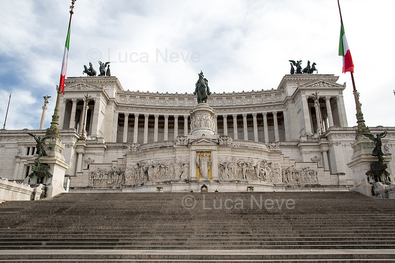 """Altare della Patria - Vittoriano.<br /> <br /> Rome, 12/03/2020. Documenting Rome under the Italian Government lockdown for the Outbreak of the Coronavirus (SARS-CoV-2 - COVID-19) in Italy. On the evening of the 11 March 2020, the Italian Prime Minister, Giuseppe Conte, signed the March 11th Decree Law """"Step 4 Consolidation of 1 single Protection Zone for the entire national territory"""" (1.). The further urgent measures were taken """"in order to counter and contain the spread of the COVID-19 virus"""" on the same day when the WHO (World Health Organization, OMS in Italian) declared the coronavirus COVID-19 as a pandemic (2.).<br /> ISTAT (Italian Institute of Statistics) estimates that in Italy there are 50,724 homeless people. In Rome, around 20,000 people in fragile condition have asked for support. Moreover, there are 40,000 people who live in a state of housing emergency in Rome's municipality.<br /> March 11th Decree Law (1.): «[…] Retail commercial activities are suspended, with the exception of the food and basic necessities activities […] Newsagents, tobacconists, pharmacies and parapharmacies remain open. In any case, the interpersonal safety distance of one meter must be guaranteed. The activities of catering services (including bars, pubs, restaurants, ice cream shops, patisseries) are suspended […] Banking, financial and insurance services as well as the agricultural, livestock and agri-food processing sector, including the supply chains that supply goods and services, are guaranteed, […] The President of the Region can arrange the programming of the service provided by local public transport companies […]».<br /> Updates: on the 12.03.20 (6:00PM) in Italy there 14.955 positive cases; 1,439 patients have recovered; 1,266 died.<br /> <br /> Footnotes & Links:<br /> Info about COVID-19 in Italy: http://bit.do/fzRVu (ITA) - http://bit.do/fzRV5 (ENG)<br /> 1. March 11th Decree Law http://bit.do/fzREX (ITA) - http://bit.do/fzRFz (ENG)<br /> 2. http://bit.do/fzRKm"""