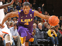 Jan. 2, 2011; Charlottesville, VA, USA; LSU Tigers guard Chris Bass (4) dribbles the ball during the game against the Virginia Cavaliers at the John Paul Jones Arena. Mandatory Credit: Andrew Shurtleff