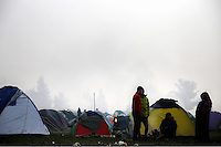 Pictured: Migrants outside their tents after a night of deluge Tuesday 08 March 2016<br /> Re: Heavy overnight rain has flooded the migrant camp at the Greek FYRO Macedonian border of Idomeni in Greece