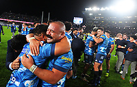 Blues' Karl Tu'Inukuafe celebrates with Blues teammates after winning the Super Rugby Tran-Tasman final between the Blues and Highlanders at Eden Park in Auckland, New Zealand on Saturday, 19 June 2021. Photo: Dave Lintott / lintottphoto.co.nz
