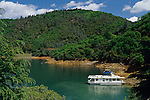 House boat in little side cove on Shasta Lake near Redding Northern California USA