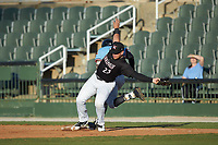 Kannapolis Intimidators first baseman Corey Zangari (23) is pulled off the base as Jonathan Ornelas (3) of the Hickory Crawdads lunges for the bag at Kannapolis Intimidators Stadium on May 6, 2019 in Kannapolis, North Carolina. The Crawdads defeated the Intimidators 2-1 in game one of a double-header. (Brian Westerholt/Four Seam Images)