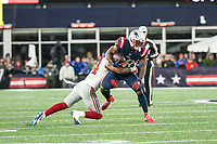 FOXBORO, MA - OCTOBER 10: New York Giants Cornerback Grant Haley (34) tackles New England Patriots Runningback James White (28) during a game between New York Giants and New England Patriots at Gillettes on October 10, 2019 in Foxboro, Massachusetts.