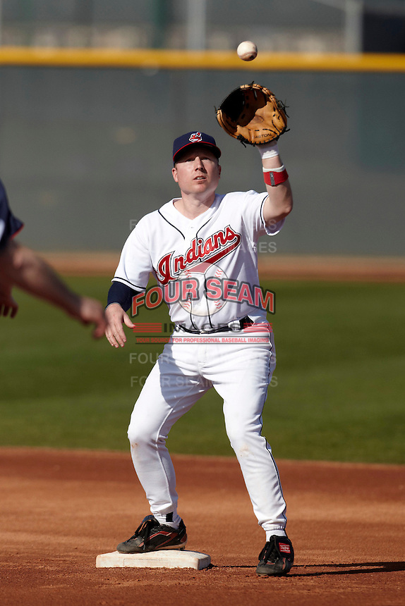Cleveland Indians Fantasy Camp member takes the throw to force out a runner during a game at Goodyear Training Complex on January 18, 2012 in Goodyear, Arizona.  (Mike Janes/Four Seam Images)