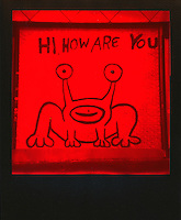 """Polaroid instant picture shot on Impossible Red film of Austin's famous """"Hi How Are You"""" Mural located on the UT Drag in downtown Austin, Texas - Stock Image."""