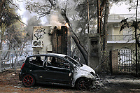 Pictured: A burned out car in Varibobi, Athens, Greece. Tuesday 03 August 2021<br /> Re: Forest fire in Varibobi, on the outskirts of Athens, Greece.