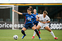 TACOMA, WA - JULY 31: Dzsenifer Marozsan #8 of the OL Reign and Savannah McCaskill #7 of Racing Louisville FC battle for the ball during a game between Racing Louisville FC and OL Reign at Cheney Stadium on July 31, 2021 in Tacoma, Washington.