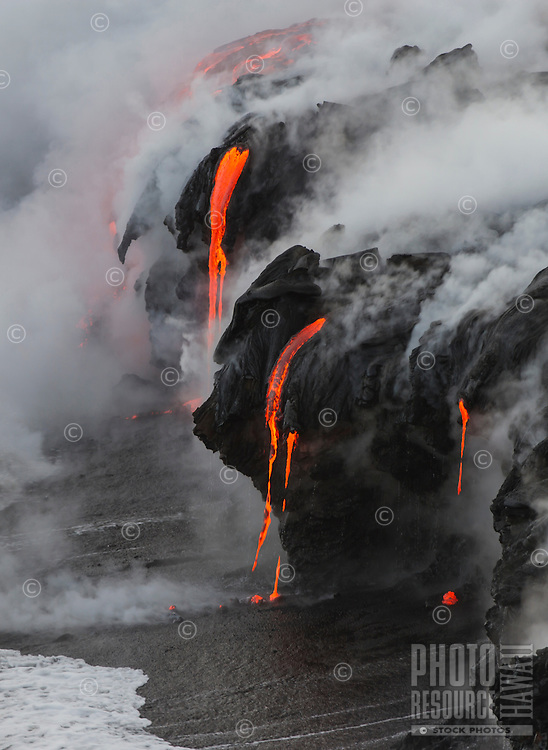 Lava enters the sea, creating interesting formations, Hawai'i Volcanoes National Park and the Kalapana border, Big Island.
