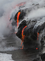 Lava enters the sea, creating interesting formations, Hawai'i Volcanoes National Park and the Kalapana border, Big Island.