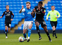 1st May 2021; Weston Homes Stadium, Peterborough, Cambridgeshire, England; English Football League One Football, Peterborough United versus Lincoln City; Sammie Szmodics of Peterborough United holds off TJ Eyoma of Lincoln City