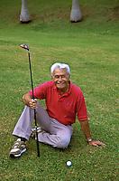 Senior Hawaiian man with golf club; Pali Golf Course, Windward Oahu
