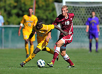 18 September 2011: University of Vermont Catamount Defender Yannick Lewis, a Senior from Toronto, Ontario, battles Harvard University Crimson Midfielder Tim Schmoll, a Freshman from Coppet, Switzerland, at Centennial Field in Burlington, Vermont. Lewis scored the games' lone goal as the Catamounts shut out the visiting Crimson 1-0, earning their 3rd straight victory of the 2011 season. Mandatory Credit: Ed Wolfstein Photo