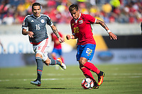 Orlando, Florida - Saturday, June 04, 2016: Costa Rican defender Ronald Matarrita (22) dribbles away from Paraguayan midfielder Celso Ortiz (16) during a Group A Copa America Centenario match between Costa Rica and Paraguay at Camping World Stadium.