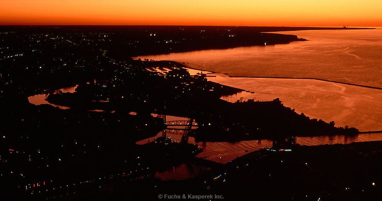 The meandering Cuyago River and Whiskey Island is seen in this sunset view looking west from downtown Cleveland, OH.