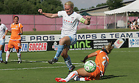 Red Stars defender Frida Ostberg leaps over Sky Blue forward Kacey White. Sky Blue FC defeated the Chicago Red Stars 1-0 on Sunday, July 19, 2009.